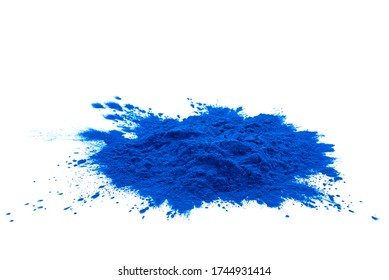 Blue spirulina powder isolated over white background. Phycocyanin extract. Natural superfood, vegan, healthy dietary supplement.