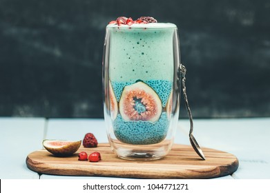 Blue spirulina smoothie and chia pudding with figs,topped with fresh fruits