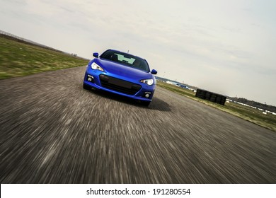 Blue sport car on race way. Motion capture.