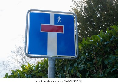 blue square with white border road traffic sign of dead end street. red and white T letter symbol. transportation and road traffic information. concept. signs and symbols.