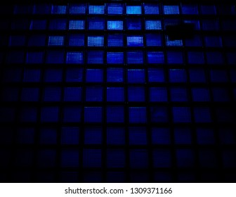 Blue Squares  Image was captured in Brasov at a hospita construction glass wall from outdoors and transformed in this geometrical darken-blue representation.