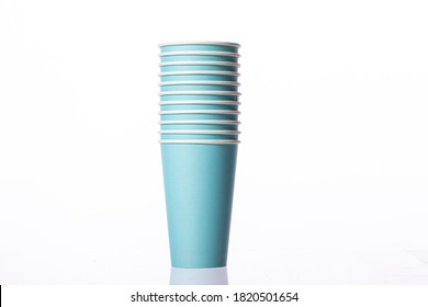 blue stacked disposable biodegradable paper takeaway cups isolated on white background. Plastic pollution reduction concept. Zero waste concept.
