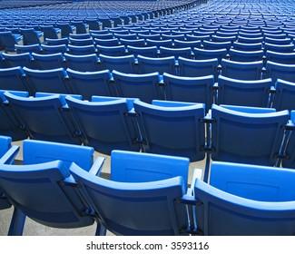 Blue stadium seats in a baseball stadium