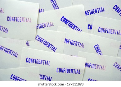 Blue stamped confidential on white memo papers