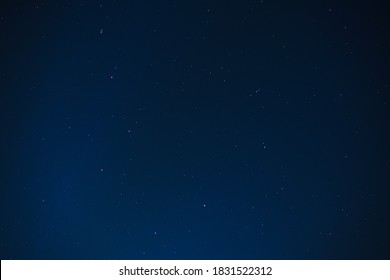 Blue starry night sky background