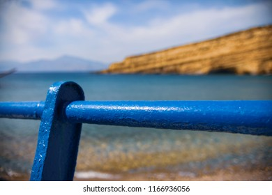 Blue steel banister and the mediterranean sea in Crete, Greece