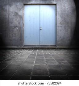 Blue steel door and concrete surrounding.
