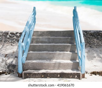 Blue step entrance to beautiful tropical beach