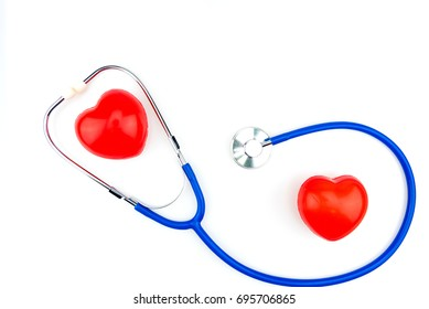 Blue stethoscope isolated and red heart on white background. Medical stethoscope and red heart isolated on white