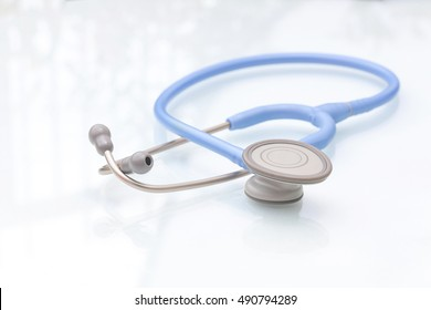 Blue stethoscope medical equipment for heartbeat check isolated on white background.