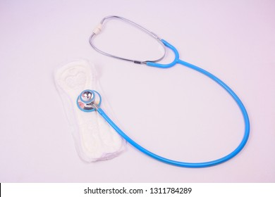 A blue stethoscope on white sanitary pad isolated on white background.