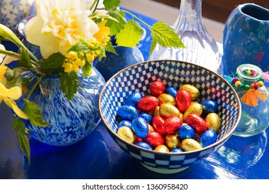 Blue still life with chocolate easter eggs and daffodils