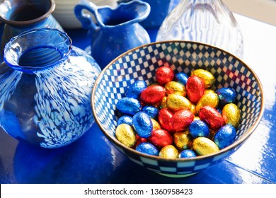 Blue still life with chocolate easter eggs