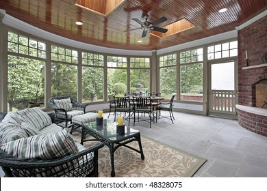 Blue stone porch with brick fireplace and skylights