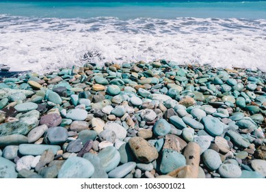 Blue Stones on a beach and ocean in Flores Island