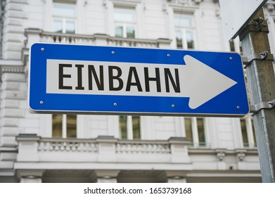 """blue street sign in Vienna, Austria with the German word for """"oneway"""" on it"""