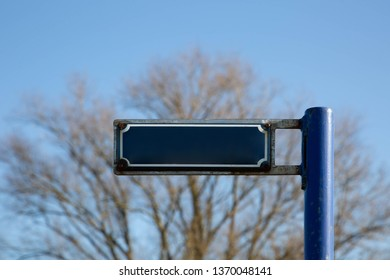Blue street sign without text