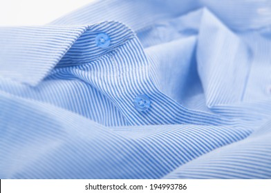 blue striped button down shirt, macro shot