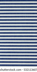 Blue Striped fabric texture useful as a background - vertical