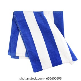 Blue stripes beach towel folded isolated on white.Summer vacation resort concept decoration.