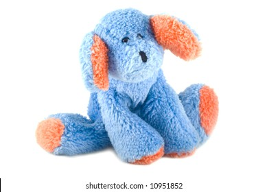 Blue stuffed animal with orange paws and ears on a white background.