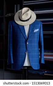 Blue stylish suit with straw hat. Men's jacket on a mannequin. Men's Clothing