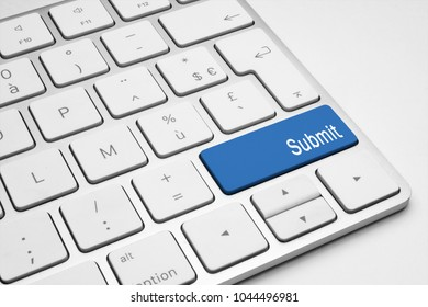 Blue Submit push button on a white keyboard