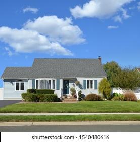 Blue Suburban Bungalow home blue sky clouds USA