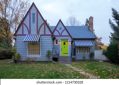 Blue suburban house with peaked roof