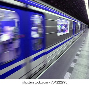 blue subway station with fast wagons in movement