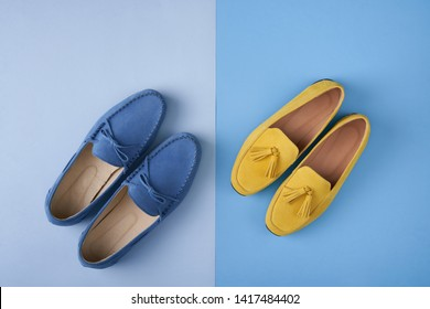 Blue suede man's and yellow woman's moccasins shoes over blue background, top view