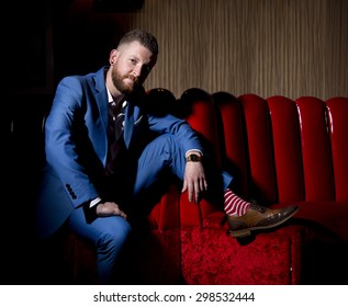 blue suit on red leather