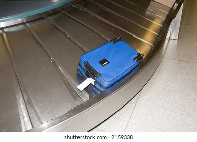 BLue suitcase at airport