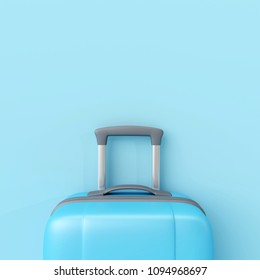 Blue suitcase on pastel blue background. minimal travel concept