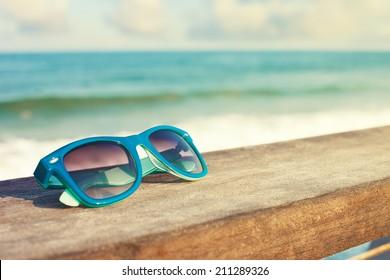 blue sunglasses and sea