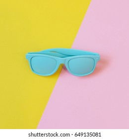 blue sunglasses for the summer for women and men. minimalist flat lay