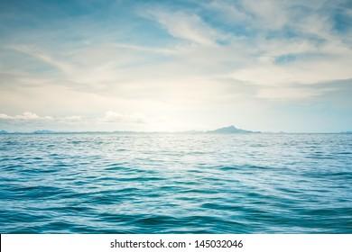 Blue sunny sea and cloudy blue sky