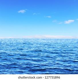 Blue sunny sea and soft sky