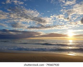 Blue sunny sky and beach