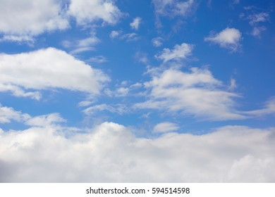 Blue sunny sky with white clouds background