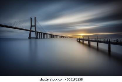Blue sunrise at Vasco da Gama Bridge in Lisbon