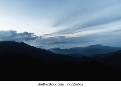 blue sunset by the mountains