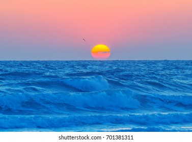 Blue sunset over the horizon of the sea in summer