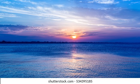 blue sunset sky over sea.intense colors. Twilight landscape. Sun at dusk. Rimini Italy