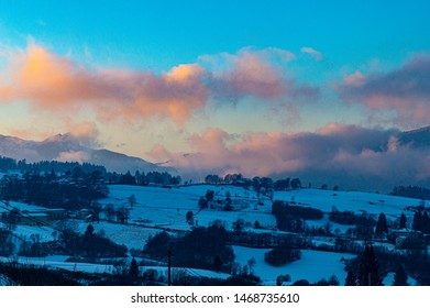 blue sunset with snow in Asiago