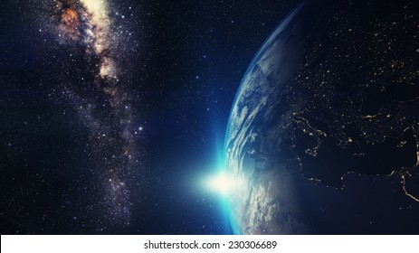 blue sunset, view of earth from space with milky way galaxy Elements of this image furnished by NASA