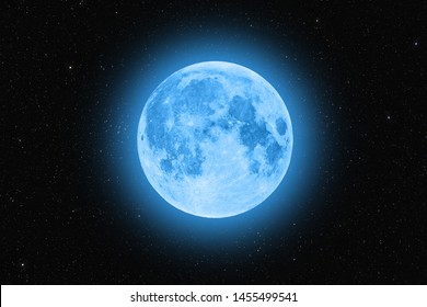 Blue super moon glowing against starry sky dark background