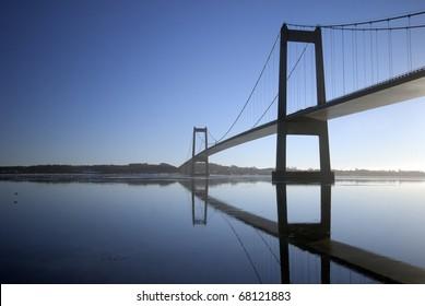 Blue suspension bridge a cold winter day in Denmark.