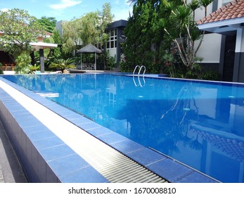 Blue swiming pool with clear clean fresh water