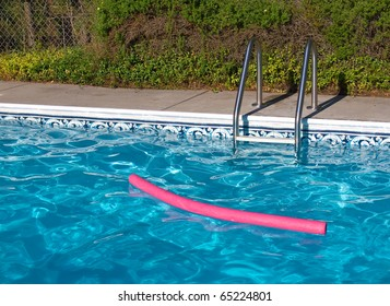 Blue Swimming Pool. Ladder, and Pink Pool Toy in Full Sunlight